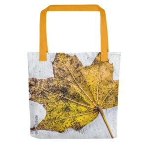 A spacious and trendy Canadiana tote bag with yellow maple leaf print to help you carry around everything that matters in style.